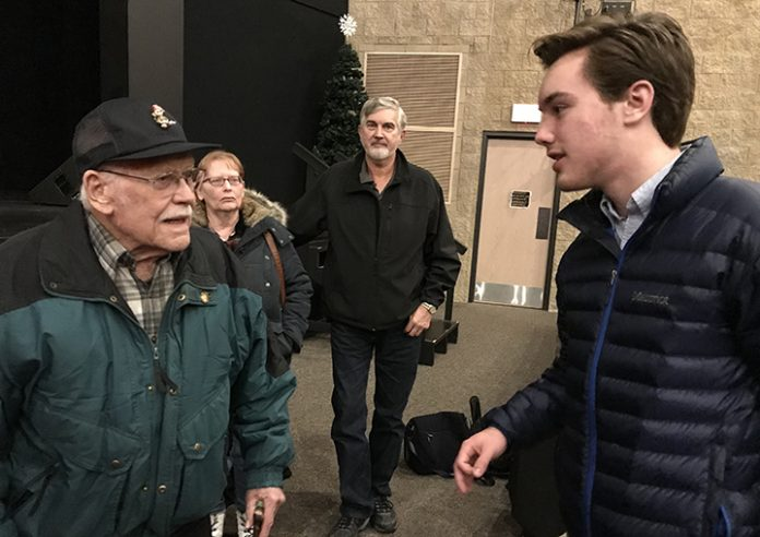 Earl Lutey, World War II and Korean veteran, chats with Byron Center High School senior Matthew Bridges