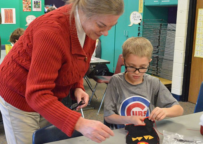 Sharon Nelson helps grandson Asher Staskiewicz