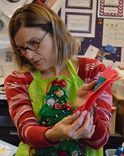 Art teacher Deborah Trent explains how to stuff and sew the dolls
