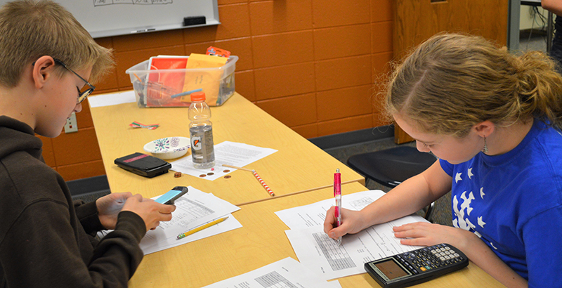 Forest Hills student Dean Raedel, left, and Alyssa Bursch, of Caledonia, team up to figure out a formula