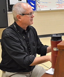 Chuck Detrich plays piano for the class and helps boys find various vocal ranges