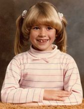 Emily McAlpine's second-grade school photograph at age 8