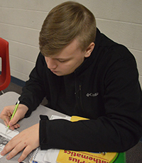 Sophomore Noah Tracey makes notes in the margin during his close read on trigonometry