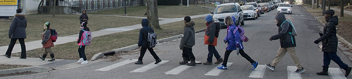 Abbey Road? Nope, Benjamin Avenue SE, as students complete their morning walk to Campus Elementary School
