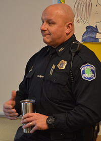 Kentwood Police Department Officer Jeff Augustyn talks to students about careers in law enforcement