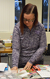 Parent Kimberly Sczesny helps label new books