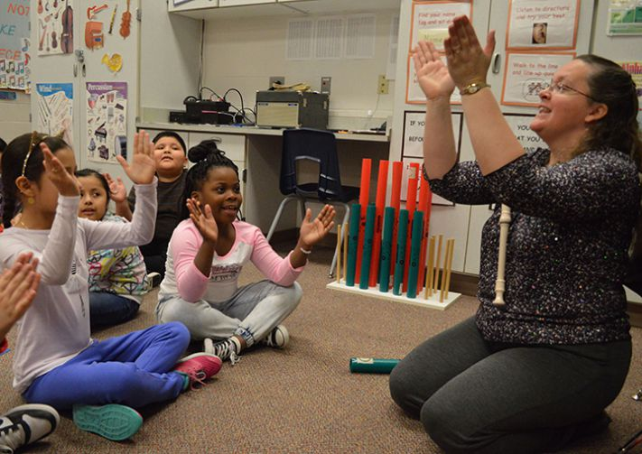 Music teacher Tami Nelson's class claps to the beat
