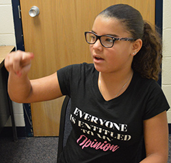 Fourth-grader Aubrianna Vernon practices spelling in the sky