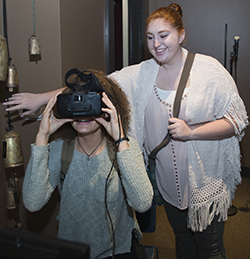 A student tries on headgear during a workshop on virtual reality at the Mosaic Film Experience