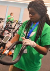 Lidie Mubiyayi of Grand Rapids Union High wipes down spin cycles