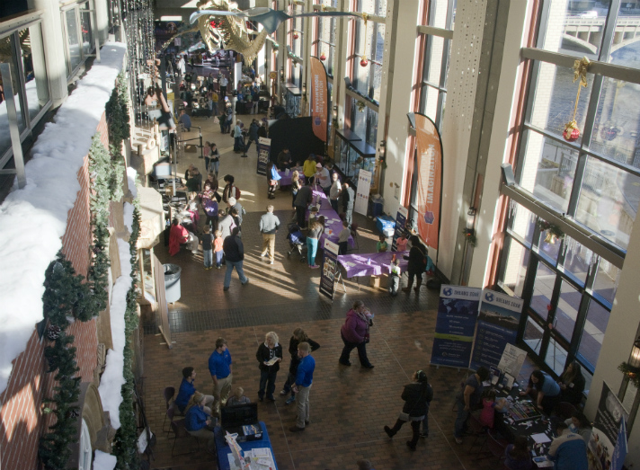 Students from around the area and their parents fill the Grand Rapids Public Museum for the daylong STEMosphere on Saturday, Nov. 12