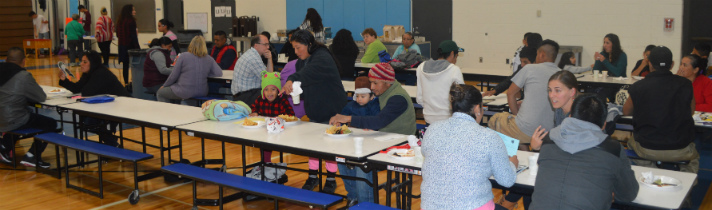 Families gather in Sparta's Ridgeview Elementary cafeteria for a fiesta, to send off families migrating south for work this winter