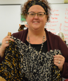 Teacher Rebecca English teaches students to knit