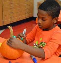Second-grader Jermaine Feagin colors his gourd