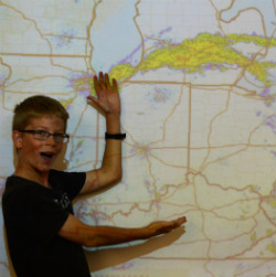A student makes like a TV meteorologist