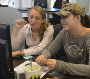 Trinity Clark, right, gets help on a geometry problem from Jacquelyn Gipe, a teacher at Success Virtual Learning Center