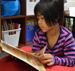 Second-grader Melody Tlung settles down to read