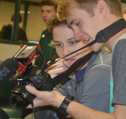 Students Matt Wilson, left, and Charlie Soucey review video footage