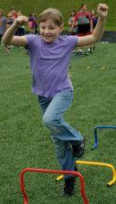 Savannah Rehfeldt races a friend on the agility course