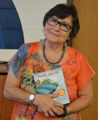 "F. Isabel Campoy holds a copy of her new book, ""Maybe Something Beautiful"" at Westwood Middle School"