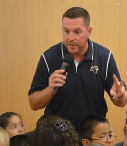 "Principal Steve Minard counts down with kindergartners before shouting, ""West Godwin rocks!"""