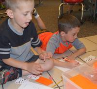 Kindergartners break into groups for math exercises in teacher Andrew Smith's Brown Elementary School classroom