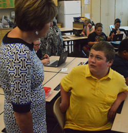 Sue Spahr chats with a student named Joe