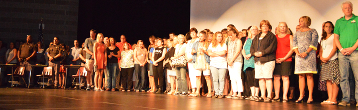 School staff, students and community members line the stage to unify in the fight against suicide