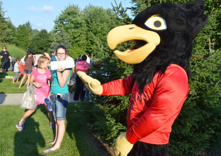 The Falcon mascot greets students