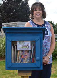 Southeast Kelloggsville Elementary School literacy specialist Janna Schneider wanted to provide an easy way for families to get books