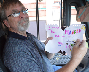 """""""I love you, Mr. Dave. Thank you,"""" reads a card to Dave Smith from a student named Delilah"""