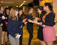 Young Women for Change members Ana Lopez and Morgan Locke (far right) pass out journals to GRPS students