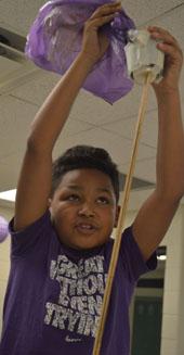 Wyoming Intermediate School sixth-grader Jamario Coleman prepares for the drop