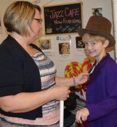 Willie Wonka, aka Trenton Brink, has his mic adjusted by music teacher Judith Stroh