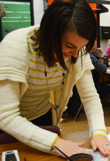 Kent City art teacher Amy Foster readies a class lesson as a group of her colleagues prepares to observe