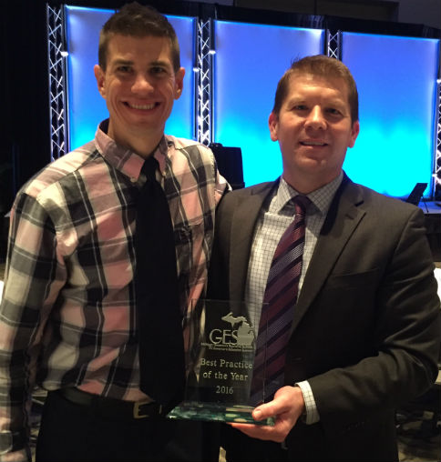 Design Lab instructor Joe Phillips, left, receiving the award with Tech Center Principal John Kraus