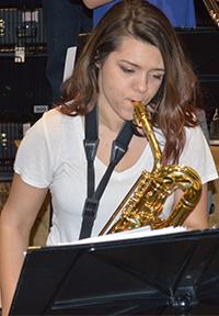 Junior Lauren Elliott plays the baritone saxophone