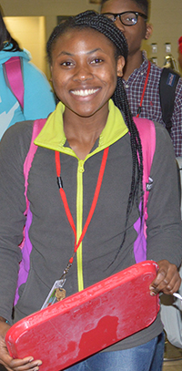 Burundi refugee student Gloria Tungabose gets her lunch