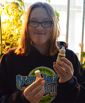 Allison Truskowski uses supplies to measure nutrients
