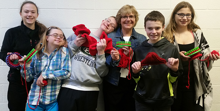 First-time loomer Forest Hills student aide Marge Hensch, center, made more than 20 caps. She is surrounded by Central Middle seventh-graders, from left, Ava Metaj, Kennedy Rudolph, Clay Udell, Joey Dixon and Madeline Ostrowski