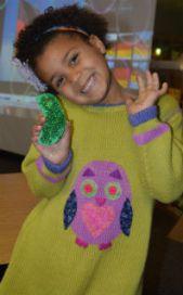 Anaya Jacobs shows off her handmade German pickle ornament
