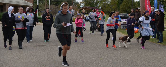 Runners race in a 5K at the fall festival