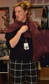 A cape whirls around Tracey Kooy