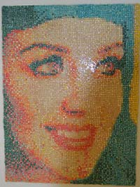 Students chewed more than 30,000 pieces of gum to create a mural of pop-artist Katie Perry with artist Tim Powers