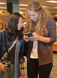 "Nopparet ""Mint"" Likhithattaslip, from Thailand, exchanges phone numbers with Veronika Rieks, from Germany"