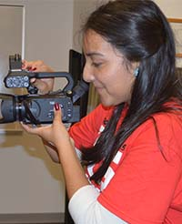 Lee High School senior Adriana Sanchez participated in the session in a different way, as videographer
