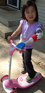 The first thing Maeli Gottschalk did when she got her robotic arm was hop on her scooter (courtesy photo)
