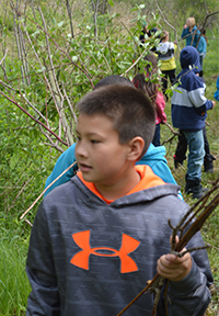 Fourth-grader Magnus Salmon works on the trail