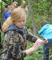 High school senior Liz Smith works with the fourth-graders