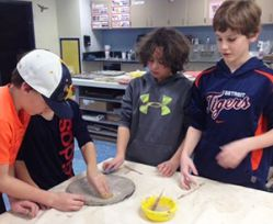Students create clay sculptures for the mural